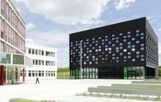 Der schwarze würfelförmige Neubau verfügt über eine sogenannte Pixel-Fassade, die durch eine Vielzahl von kleinen, versetzt angebrachten Fenstern entsteht. Ein Design, das keine Geschossaufteilung von außen erkennen lässt.
